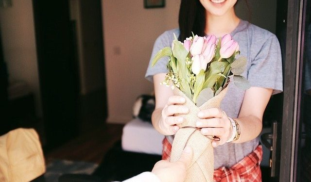 A girl is given a flower bouquet