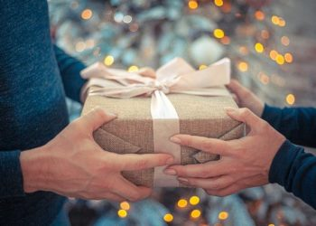 Handing over gift by girl to boyfriend