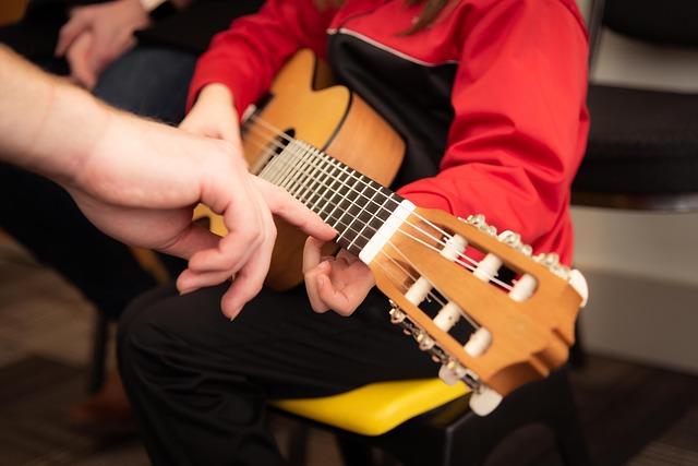 Teaching how to play the guitar