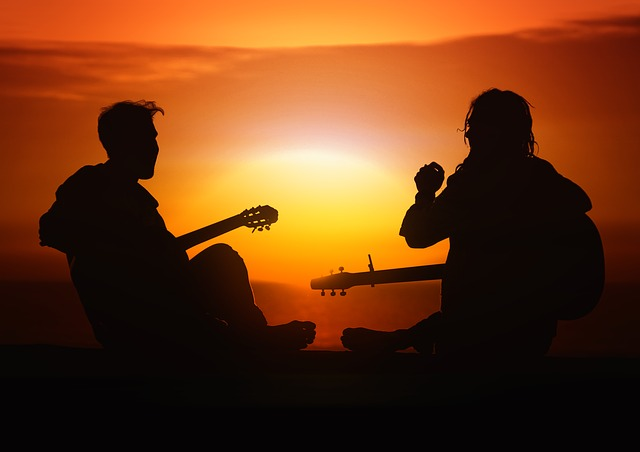 5 best tips to practice guitar  - Two men playing guitars in evening