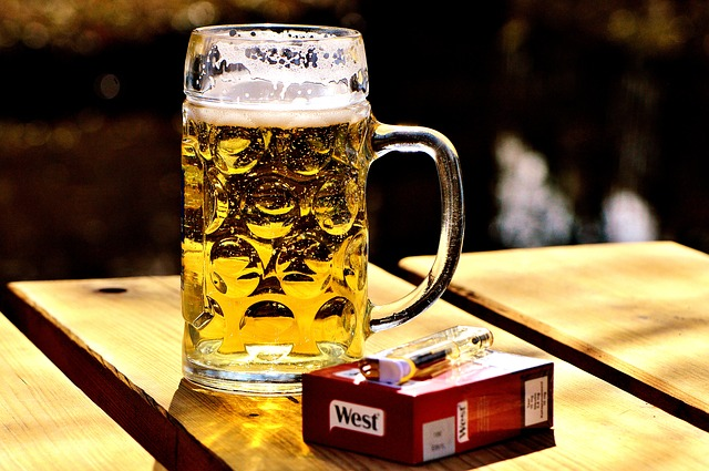 5 things to reduce your weight - A glass of beer and a cigarette box