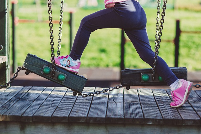 Young girl is trying to climb steps - 5 things to talk about with your children every day