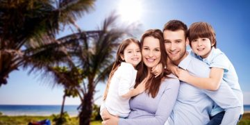 Happy young parents with two children