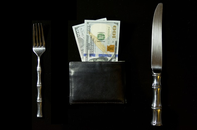 Five things to try if you want to be happy in your life - Knife fork and a wallet with money