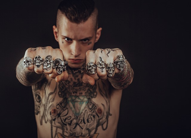 A boy with tattoos in the whole body