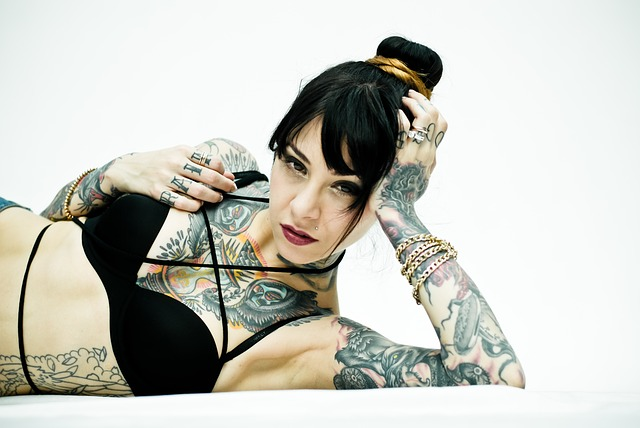Reasons for tattoo designs - A girl with tattoos