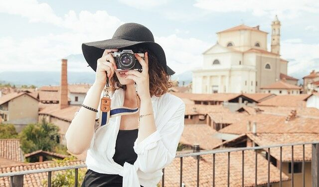 Travel girl with a camera