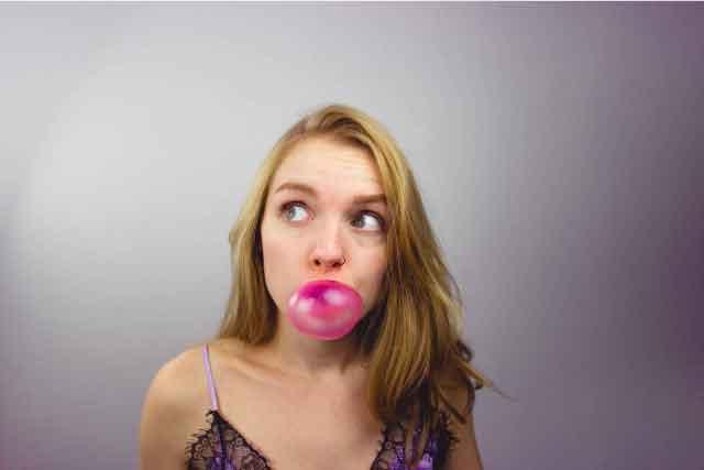 Girl chewing a bubblegum