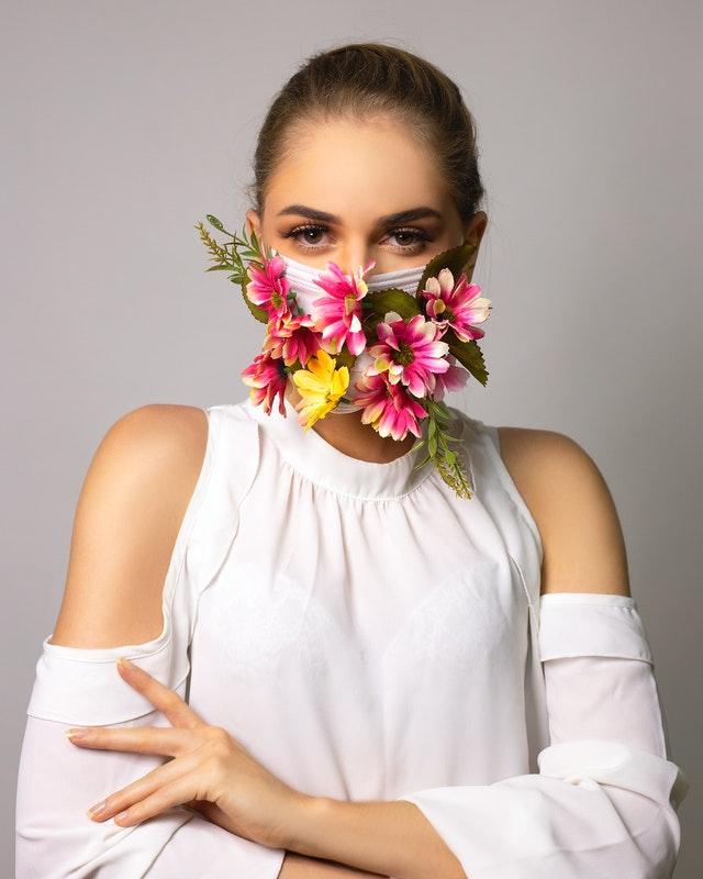A girl wearing a beautiful face mask